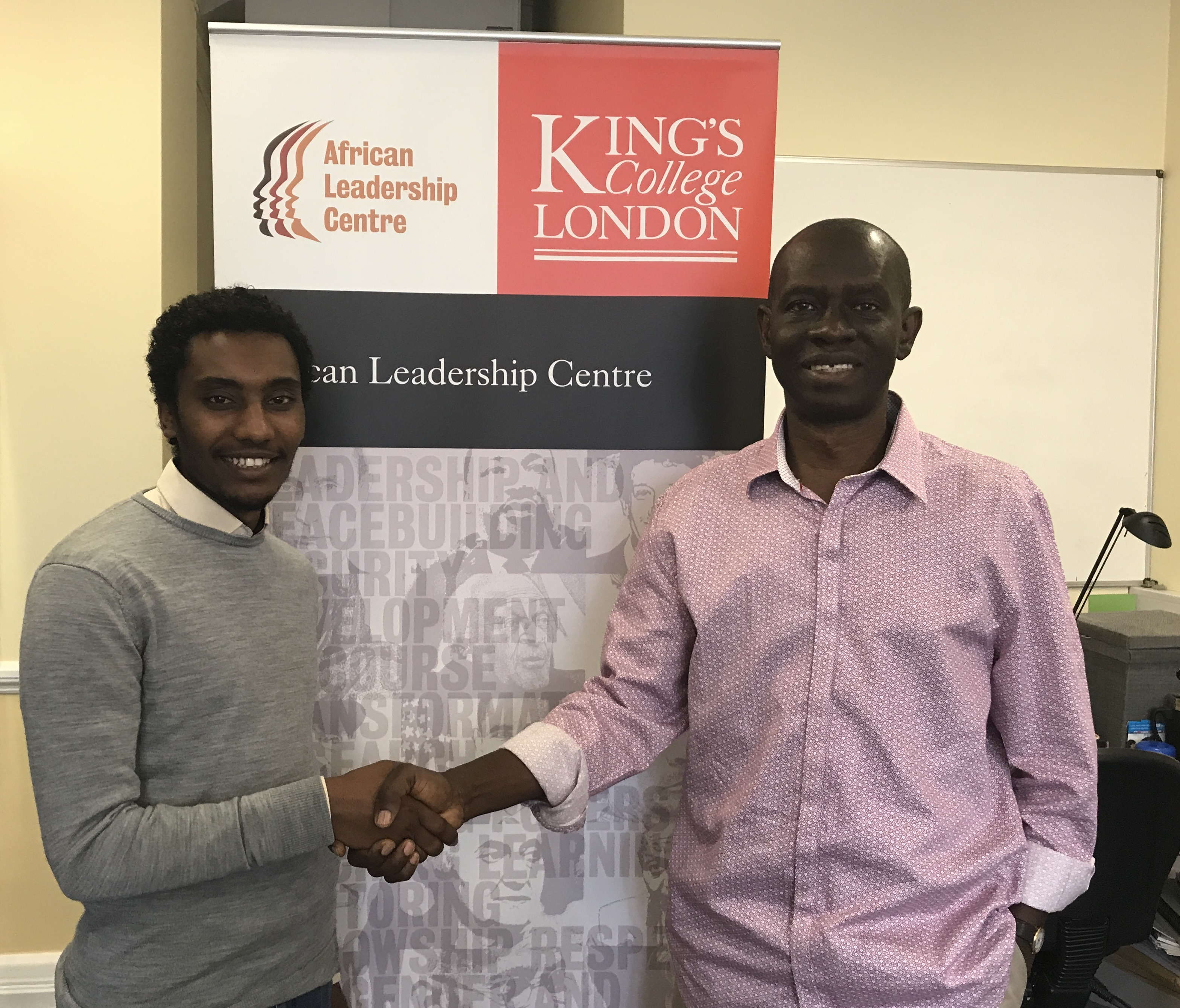 Zekarias being congratulated by Prof Abiodun Alao, Programme Director at ALC and Chair of the African Community of Practice, King's College London.